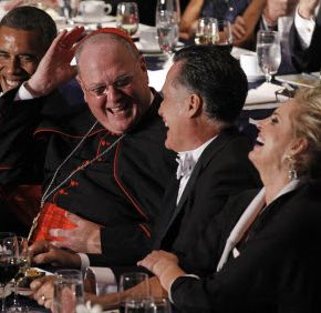 Cardinal Timothy Dolan shares a laugh with President Barack Obama, Republican presidential nominee Mitt Romney and his wife, Ann, at the Alfred E. Smith Memorial Foundation Dinner in New York Oct. 18. The dinner honors the memory of the former governor of New York, who was raised in poverty and was the first Catholic nominated by a major political party to run for president of the United States.