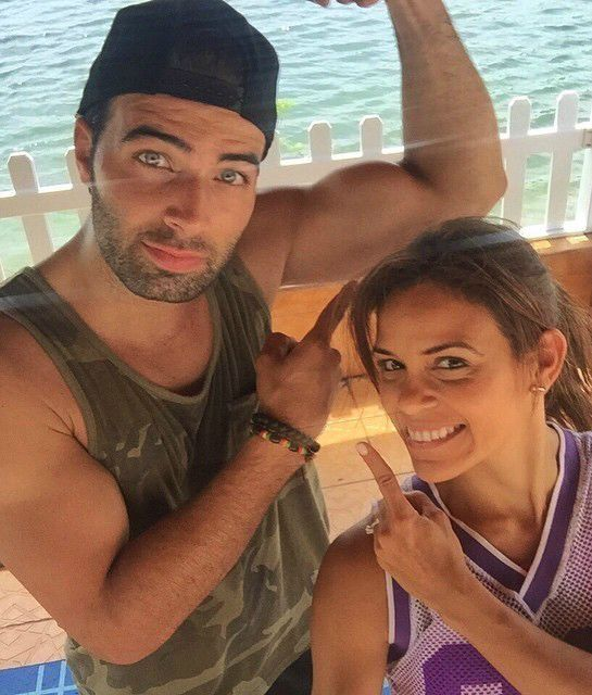 Do you think Cuban-American actor and singer Jencarlos Canela got those biceps from carrying around his son, Nickolas? Workouts at the beach probably have more to do with those guns.