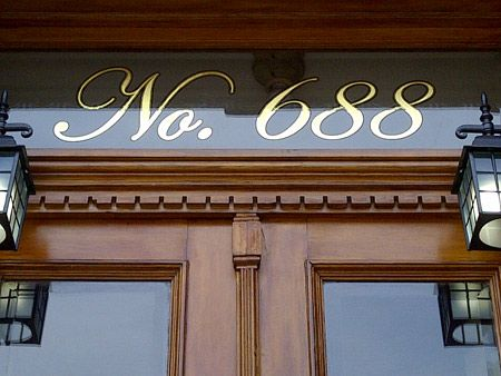 Wish I had a transom for my house numbers -  brownstone transom numbers