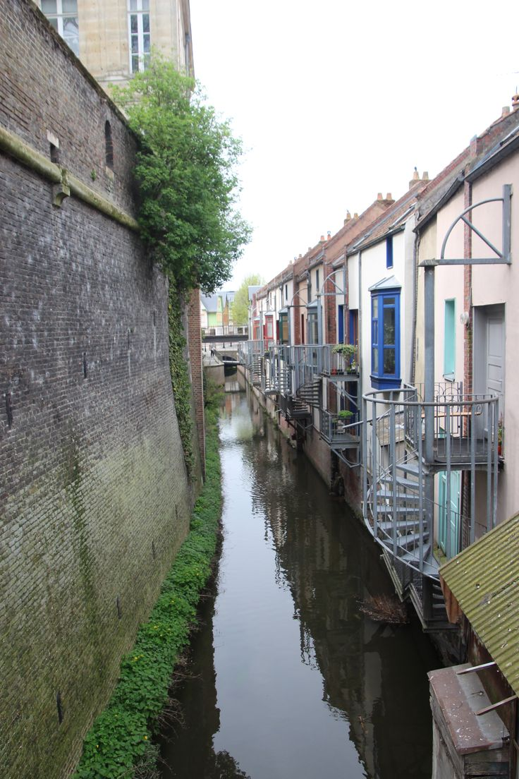 Spiralling staircases from homes backing unto canal. Amiens, France