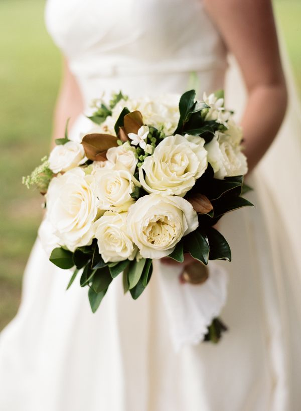 classic southern bouquet with magnolia leaves photographed by olivia griffin and designed by rick childers