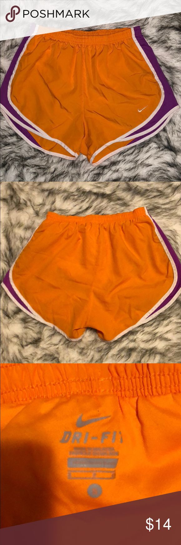 Woman's Orange Nike DRI-FIT Shorts Size Small These Nike shorts do have the attached brief. They are orange with purple and white accent colors. Looks great, just some normal wear and tear Nike Shorts