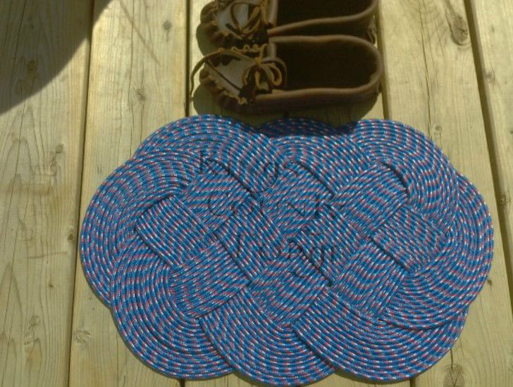 """Decorative """"Ocean Plait""""  Rope Mat - Kings County Forge  This fantastic looking Ocean Plait mat is made from one continuous piece of rope, that is interwoven to create this decorative and versatile rope mat.  Measures approx 22″ x 14″"""