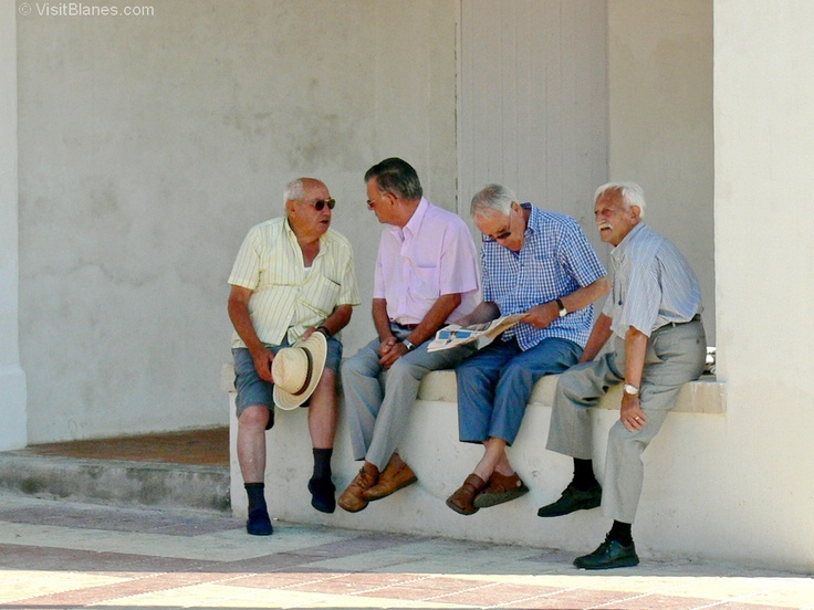 Retired fishermen shooting the breeze in Blanes