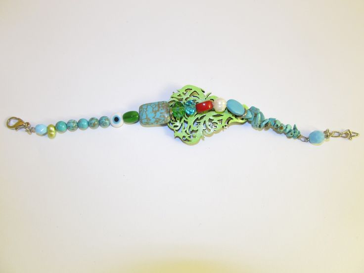 Handmade leather bracelet (1 pc)  Made with light green laser cut leather filigree, coral, turquoise stones, freshwater pearls and glass beads.