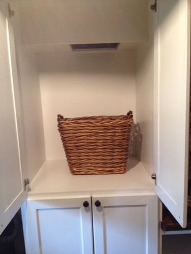 Build a cabinet under the laundry chute. This basket is way too small though.