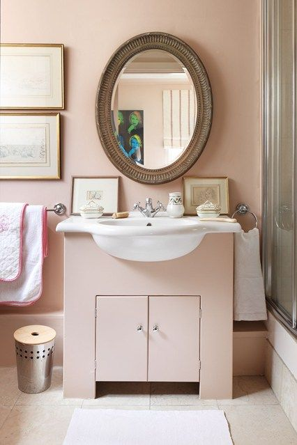 Small Pink Traditional Bathroom in Decorating Ideas for Small Flats & Studio Apartments, inbuilt sink unit and antique mirror, matching pink towels.