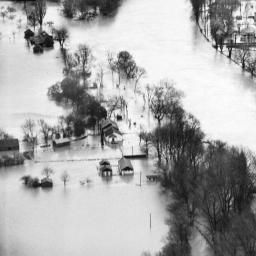 The River Thames in flood around the town Gas Works and Staines Bridge, Egham, 1947 | Britain from Above