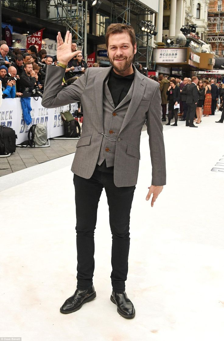Rock 'n roll: Kasabian's Tom Meighan rocked up in a three-piece suit and rugged facial hai...