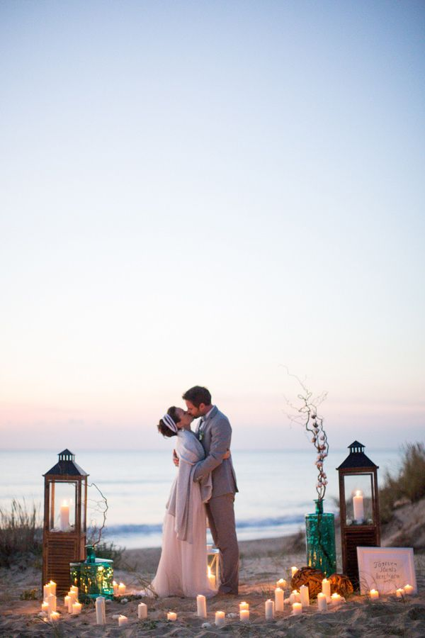 perhaps the candles aren't super practical for the actual aisle-to-minister transition ... but they sure do frame a picture nicely  (beach wedding ceremonies via ruffledblog.com)
