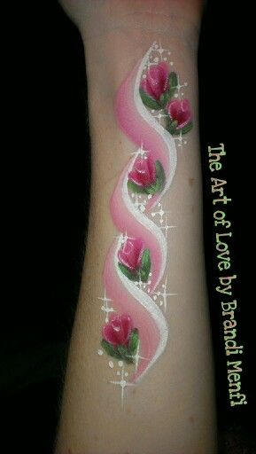 Rose face paint doodle. Would be pretty on the upper arm.