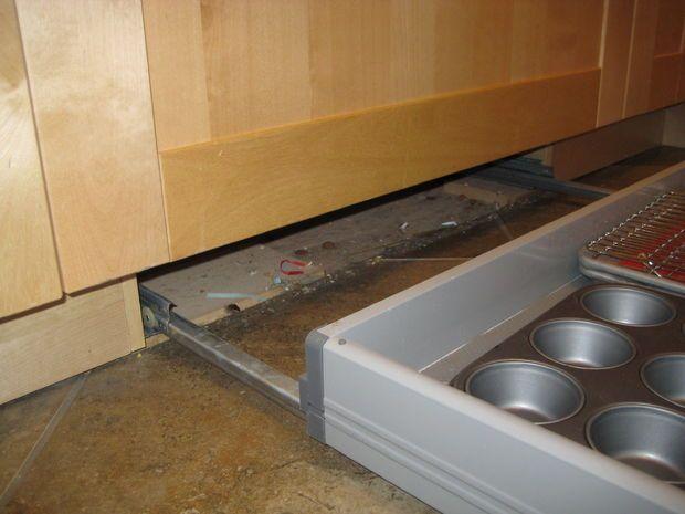 Ikea base cabinet hack to create kickboard drawers. 2008 09 September- 027.jpg