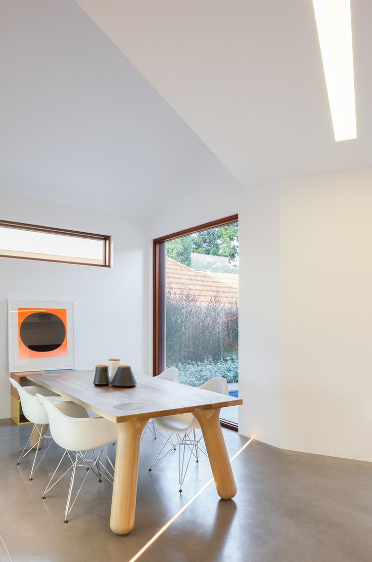 Interior in white with timber frame windows at Naremburn House by Bijl Architecture