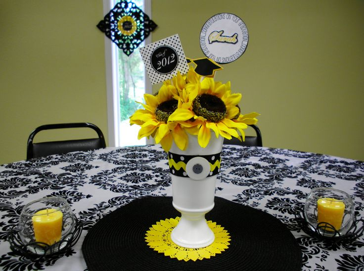 Graduation Party Theme using black, yellow and white. Used Dollar Store materials and scrapbook paper to make centerpieces!