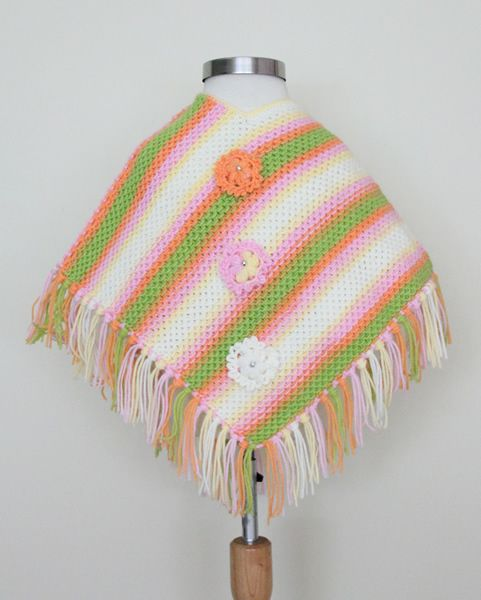 http://www.woollyandwarmy.com/collections/baby-pancho/products/baby-pancho