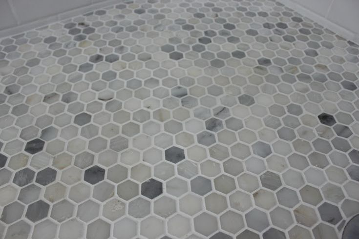 bathroom floor tile  Great for in walk in shower.... With lite colored subway tiles.
