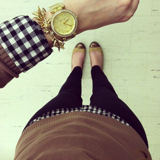 black gingham and camel sweater with black pants