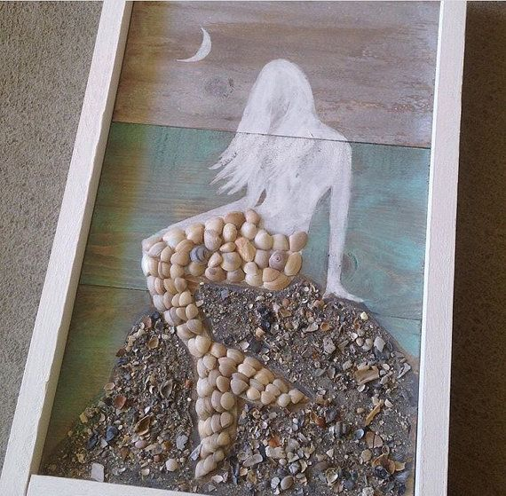 Size: 10 1/2 x 16 1/2  Hand painted Mermaid with tail decorated in collected seashells, sitting upon a rock of crushed seashells all from Charleston beaches.  Hangs from ledge on the back. Bathroom safe...seashells attached with industrial glue.  This sign is maid to order. Please allow 1 to 2 weeks to complete.  Thanks for looking