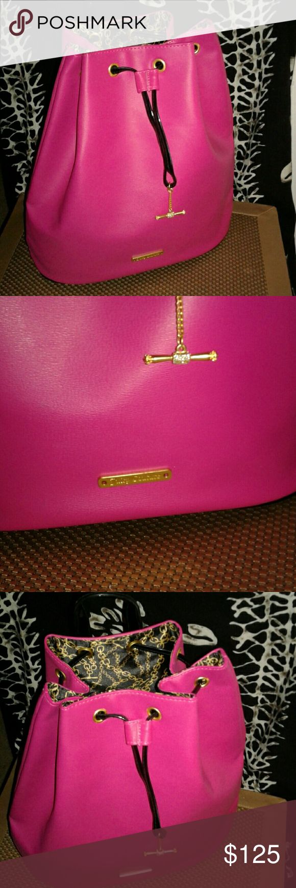 Juicy Couture Backpack/Purse bright pink and shiny black  Beautiful workmanship and detailed with gold accents perfect condition as shown  Excellent condition outside and inside  silk lining 15 inches wide and 13 inches length  6 inches depth  Adjustable straps approximately 40 inches to adjust length it's sturdy but not heavy heavy! just right! Lol Juicy Couture Bags Backpacks