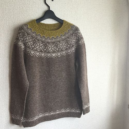 This Norwegian inspired, circular-yoke sweater is worked seamlessly from the bottom up. The sleeves are worked first, for ease of checking gauge. Then the body is worked with some subtle waist shaping. Short row shaping is added for an optimal fit at the shoulders and neckline. Lastly, the stranded yoke is knit. There are no long strands, which makes for easy stranded knitting.