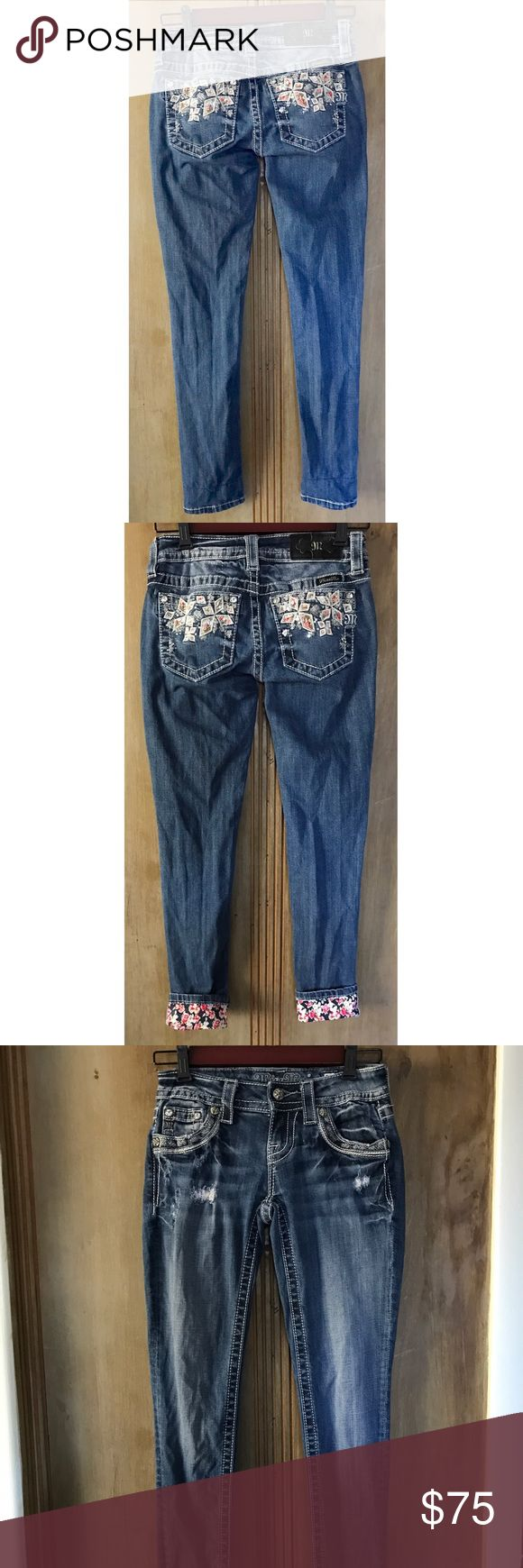 """Miss Me Signature Cuffed Skinny Jeans Miss Me signature cuffed skinny jeans. Can be worn cuffed with adorable floral pattern showing or worn regularly without the cuff. Back pockets mimic the cuffed floral pattern and are stitched with silver thread and sequins. Front pockets are stitched with a silver border. Some distressing at the front pockets. Inseam is 27"""" when cuffed and 29.5"""" when not. Waist is 24"""". Gently used. Miss Me Jeans Skinny"""