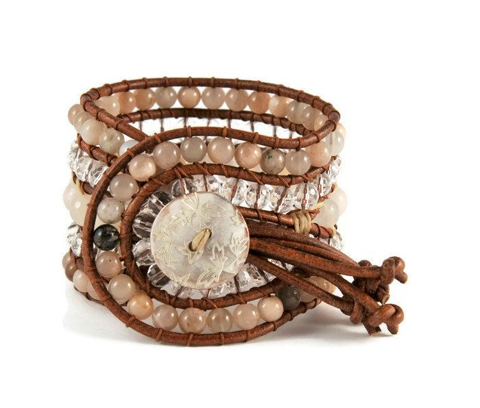A 5 strands women's bracelet is handcrafted with semi precious stones of aventurin, sun stone & crystal. All of them are framed by natural brown leather woven together with brown cotton cord. This easy - to - wear design also features a metal, bronze, vintage, lightly hammered, details button closure. This gorgeous bracelet pairs beautifully with other gold tone pieces, but can also make a subtle shimmering statement worn alone.