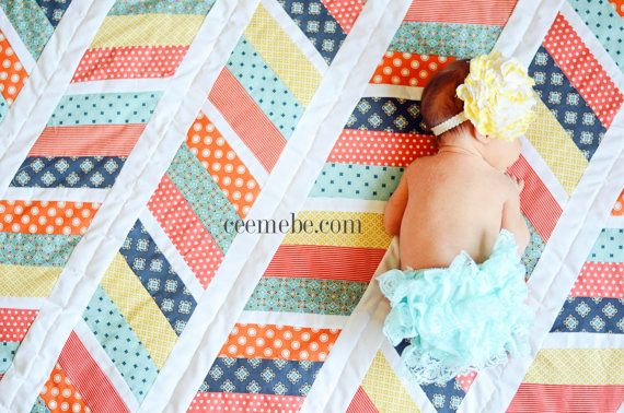 """Herringbone Quilt Tutorial & Pattern - Toddler & Crib size  This quilt tutorial is written for the beginner seamstress. The completed quilt will be 48""""x54"""" Perfect for babies and toddler beds!  You CAN use 2 Jelly Rolls for this pattern if you so choose. This pattern takes about 9.5 yards of fabric to complete. You can change the pattern to be larger or bigger blocks but I do not provide instructions on how to do this or the amount of fabric it would take. But feel free to experiment. :)…"""