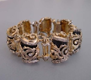 DEROSA sterling vermeil, clear rhinestones and black enamel scroll design bracelet , circa 1947