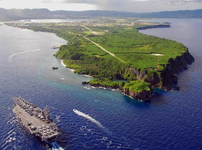 """Guam, an island territory of US, located 900 miles north of equator in Western Pacific, an island about 4 - 8 mi wide & 32 mi long, making it largest landmass in Micronesia. Because of location from International Date Line, Guam is first to experience a new day in US, thus island is """"Where America's Day Begins."""" Under Treaty of Paris, Spain ceded Guam to US on Dec 10, 1898, people of Guam have been U.S. citizens since 1950."""