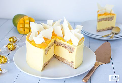 Mango and White Chocolate Mousse Cake | A true centerpiece and a celebration of Mango and white Chocolate. The delectably chewy dacquoise is the perfect contrast for the light mousse.