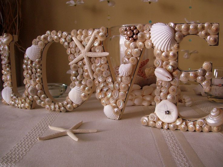 DIY Beach Wedding Inspiration Idea - Made with some skill, be inspired to create this unique Nautical Beach Wedding Seashell Wedding Sign by following our DIY tips!   #Wedding #Beach #Theme #DIY