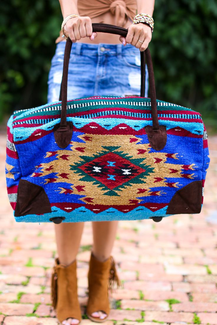 """OMG! Oversized weekender travel bag in bohemian beautiful SouthWestern blanket fabrics. This bag is an oversized large weekender measuring 22""""L x 11""""W x 13""""H and has feet to keep the bottom clean, gen"""