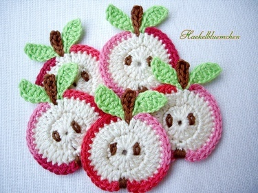 Crochet apples just right for embellishing bibs and baby stuff