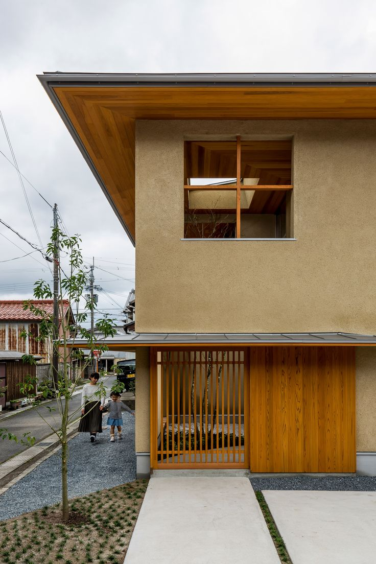 This family house in Japan's Shiga prefecture was designed by local studio Hearth Architects around an indoor garden, which is planted with a tree that extends towards a skylight.