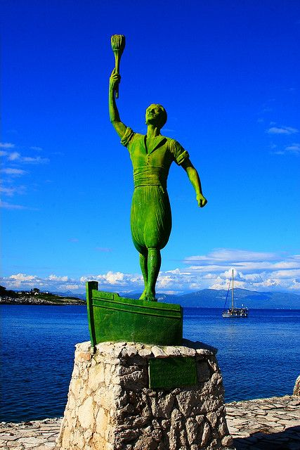 Green Man statue and sailboat. Gaios, Paxos island, Ionian, Greece -P.S!