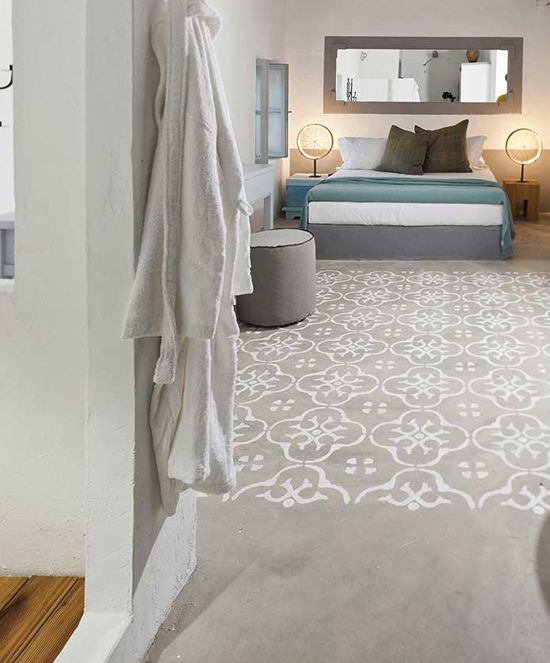 via See more at Grecian Paradise: Coco-Mat Eco Resdences in Serifos Island, Aegean sea. Stenciled concrete floors.