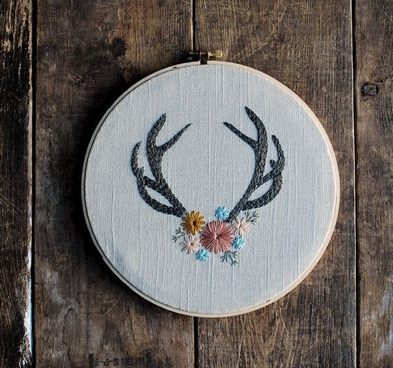 Adorned.    The embroidery is framed in an 8 inch wooden embroidery hoop. The back is left unfinished to show the reverse stitching.    ***Because this