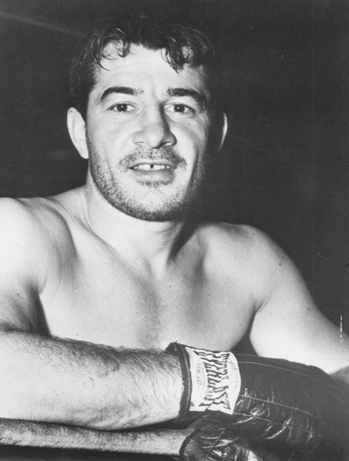 Rocky Graziano, born Thomas Rocco Barbella in New York City (1 January 1919 – May 22, 1990), was an Italian American boxer. Graziano was considered one of the greatest knockout artists in boxing history, often displaying the capacity to take his opponent out with a single punch. He was ranked 23rd on Ring Magazine's list of the greatest punchers of all time.