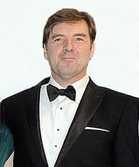 Brendan Coyle - Brendan Coyle is a British actor, born 12-2-63.  He has garnered a wide audience on TV recently as John Bates, the valet at Downton Abbey, earning a nomination for a Primetime Emmy Award for Outstanding Supporting Actor in a Drama Series.  He has numerous awards and honors for his work in the UK, credits dating from the early 1990s.  At Downton, he is Lord Grantham's valet; husband of Anna, widower of Vera, and recently released from wrongful imprisonment over Vera's death.