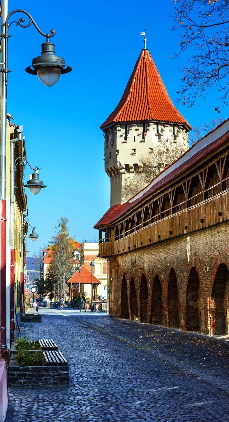 Medieval tower of stone-walled fortification of ancient city of Transylvania, Sibiu, Romania.    |   Discover Amazing Romania through 44 Spectacular Photos