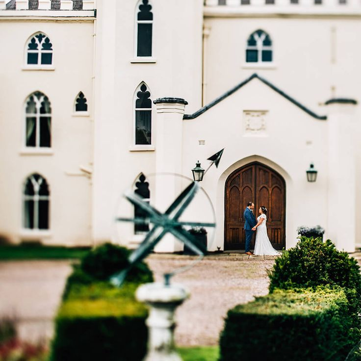 A couple hold hands at the door of this truly unique wedding venue - Shropshire wedding venues #combermereabbey #cheshirewedding