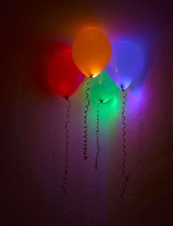 Party balloon decoration - put glow sticks in balloons. Could float in pool or make garland.