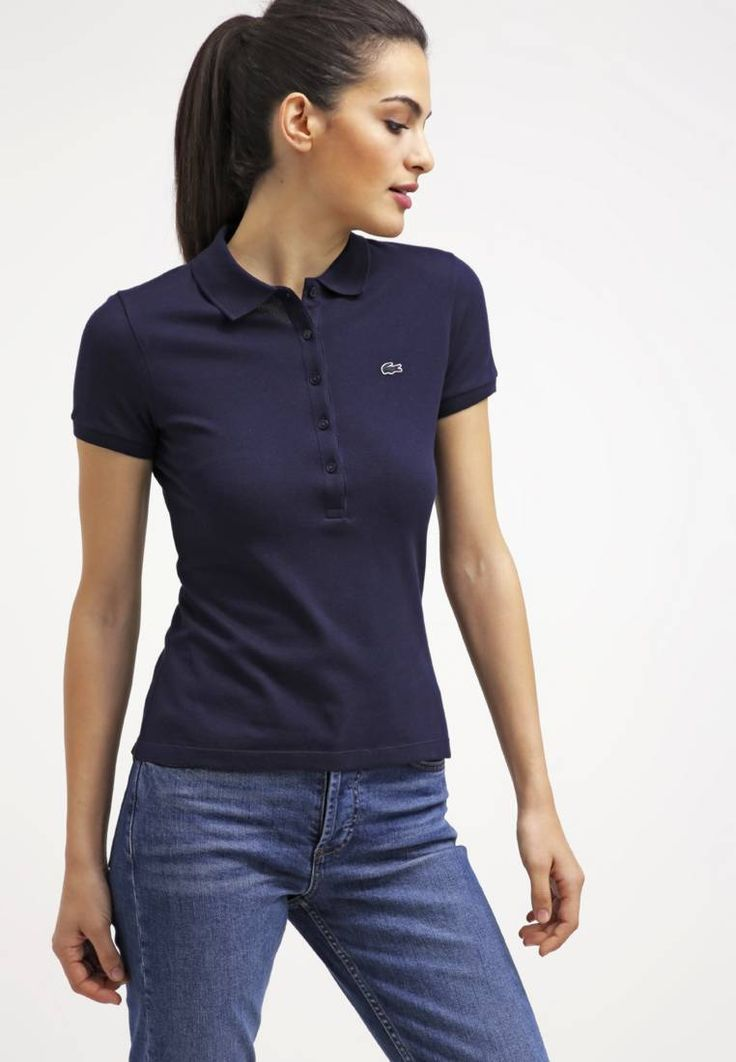 """Lacoste. Polo shirt - marine. #PoloShirt Fit:regular. Outer fabric material:94% cotton, 6% spandex. Our model's height:70.5 """". Pattern:plain. Care instructions:machine wash at 40°C,do not tumble dry. Length:normal. Sleeve length:short. Co..."""