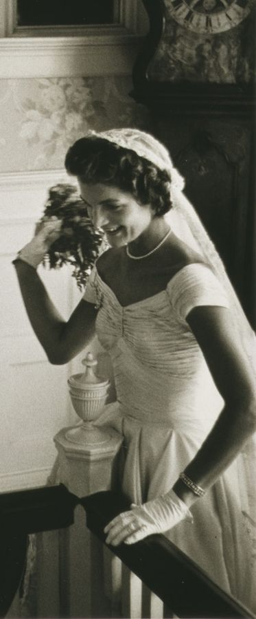 Jackie throwing the bouquet at her wedding, 1953