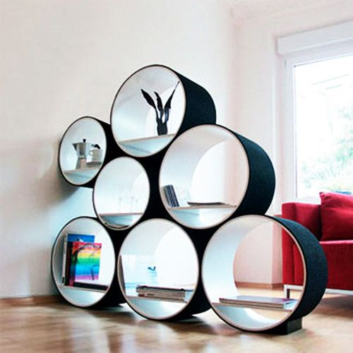The crazy circles as a room divider - I love it that they are not the same suze    http://www.design-decor-staging.com/blog/wp-content/uploads/2012/02/shelves-shelving-units-storage-ideas-3.jpg