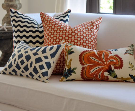 Pillow and color...navy and orange.... like the patterns excluding the flower pillow