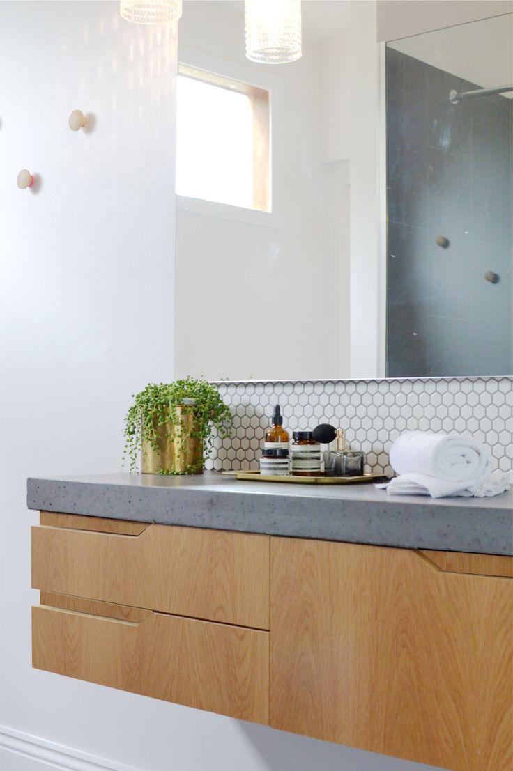 hexagon splashback, grey floor tile, cement like benchtop, timber joinery, finger pulls