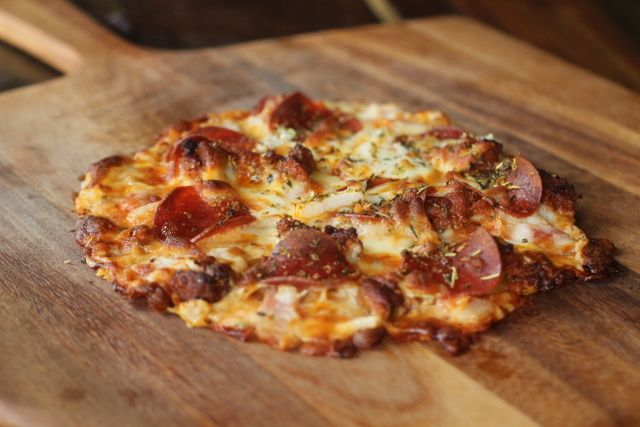 """Hi everyone, this is Craig.  This recipe is a followup to one of my first posts.  It is a twist on my popular """"Amazing Pizza"""", which is a hand tossed style pizza crust that really is amazing.  Well, thanks to a tip from a reader, we have converted this into a great thin crust style pizza."""