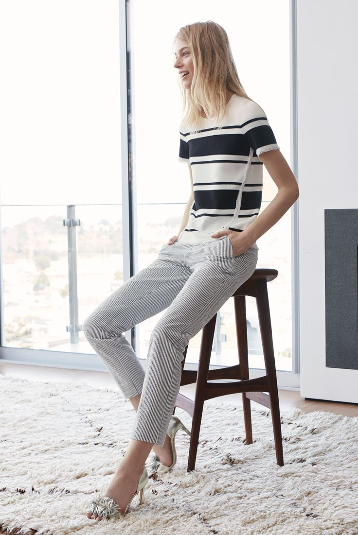 Our new spring arrivals will have you swooning! We love this black and white striped fray short-sleeve sweater. Pair it with a pair of soft seersucker pants and pale gold fringe pumps for a polished spring outfit | Banana Republic