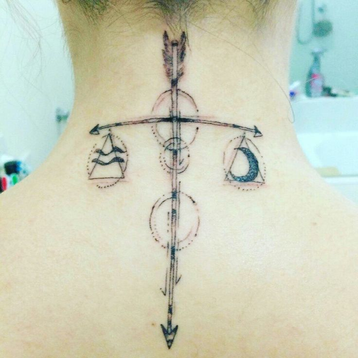 Adaptation of Libra scales. My first tattoo on the back of my neck. Love the arrows and the moon. Definitely going to get more with kind of design.